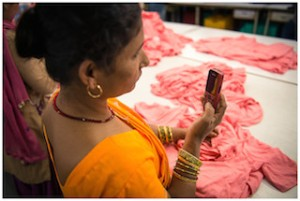 Image: Factory Worker Using SMS